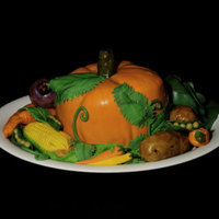 Thanksgiving 100% Edible Cake photo is a vanilla cake with chocolate filling for the pumpkin, draped in fondant. The corn, peppers, carrots, potatoes, cabbage, beet, and...