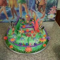 Tinkerbell TinkerBell and friends 6th birthday. Fondant wings, crown and flowers.