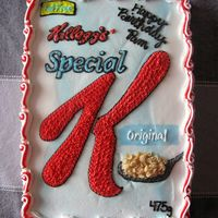 Special K This cake was a chocolate 1/4 slab covered in BC icing. The cereal on the spoon is actually Special K :) The Birthday girl is a Special K...