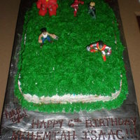 Super Hero Battle In Grass Cake My son's 6th birthday cake. Super hero's power up in the grass!