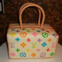 Louis Vuitton Purse Two 1/4 sheet cakes cute in half and stacked. The flavor was Jamaican Rum cake with vanilla buttercream. Covered in MMF and LV logo hand-...