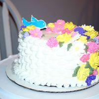 Wilton Class 2 Vanilla Pound, buttercream icing and royal icing flowers. Color flow bird.