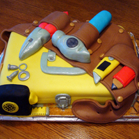 Toolbox Cake Devils Food with chocolate ganache filling and marshmallow fondant icing and tools.