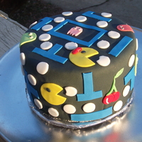 "Mr And Mrs Pacman Cake This was birthday cake i made for a friends mom who LOVES Pacman. It's done on a 6"" round with Cookies n Cream filling."