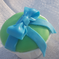 A Gift For You Cupcake   First time trying a fondant bow! My lines could have been cleaner but i'm still learning!