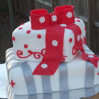 Chirstmas Package Cake A friend of mines asked me to do a Christmas package cake for her job's holiday party. I just winged it and came up with this. 2...