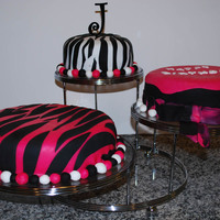Daughter's Birthday Cakes Made these for my daughter's birthday. Pink zebra cake is strawberry cake with strawberry cream cheese icing. Other two cakes are...