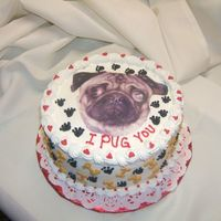 Valentine Pug Photo of Maggie the Pug copied onto frosting sheet. Dog bones and paws decorate the sides. Hearts and paws on top. Triple chocolate cake...
