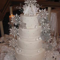 Snowflake Wedding This is a four tier red velvet cake coverd in fondant, edible silver beads, crystals, and snowflakes!