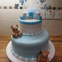 Teddy Bear Christening Cake All the decoration on this cake was made from fondant.The bottom layer is rich chocolate sponge filled with chocolate fudge filling.The top...