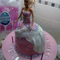 Barbie Cake This cake was made up of four seperate pieces of sponge, with a circle cut out of the centre for the doll to be inserted. This was for my...