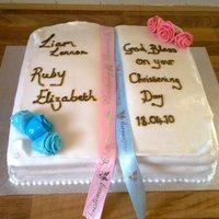 Bible Christening Cake This cake was made for my neice and nephews christening!! It is an open bible, with handmade roses in the corner, it was for a boy and girl...