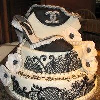 Chanel Purse And Shoe Birthday Cake! Black detail made with a tip 1 and royal icing, cakes covered in mmf, the purse is made out of cereal treats covered in mmf, the flowers...