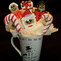 Santa Claus Is Coming To Town Cookie Bouquet This is the first cookie bouquet I have ever made. I have learned a lot about cookies this season and I think they might be a new thing for...
