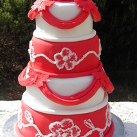 Red & White  This cake was a few firsts for me. First time doing drapes & brush embroidery. Bottom & top tiers are Port Wine Mud Cake & the...