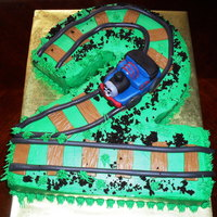 Thomas The Train chocolate cake covered with bc thomas and the trail is fondant