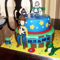 Toy Story vanil cake and chocolatecake with buttercream frosting covered with fondant ...allthefigures are gumpaste