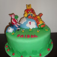 Winnie The Pooh chocolate cake with chocolate buttercream frosting covered with fondant all the figure are gumpaste ..TFL