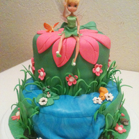 "Tinkerbell Cake With Waterfall This is a 8"" round bottom with a 6"" top. Covered with fondant than Dazzled with fondant decor. Tinkerbell was real doll."
