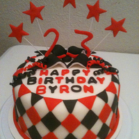 "Black And Red 8"" Round Birthday Cake made with Chocolate Fudge Cake and Buttercream Icing. 8"" round 2 layer. Dazzled with Fondant decor."