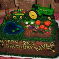 Tractor Cake! I made this tractor cake modeled after a similiar one I saw online for my son's 2 year old birthday. I added a jello pond complete...