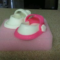Baby Shoes Using the template on cake central I made these little baby shoes. Not too shabby for my first ones.