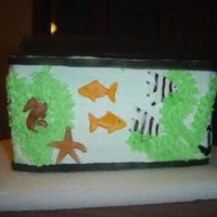 Fish Tank  This is for my the sisters sons 2nd birthday he loves fish!! There are 6 angle fish, 4 gold fish, 2 seahorses, 1 starfish and one anchor...