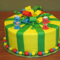 Sesame Street Cake Sesame Street Elmo and Cookie Monster are candles. Cake is covered in buttercream