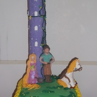 Rapunzel's Tower Rapunzel cake made for my daughters 6th birthday. Vanilla rainbow cake with vanilla buttercream. gumpaste figures and accents the tower was...
