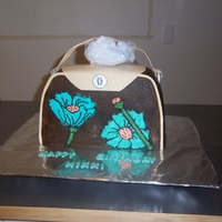 Brown/ Turquoise Handbag   vanilla cake with chocolate buttercream frosting, buttercream flowers, fondant/gumpaste accents