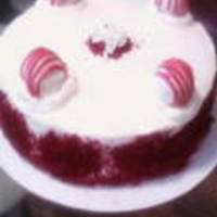 "Red Velvet Cake 8"" round - layered red velvet cake w/cream cheese icing & red velvet truffles on top"
