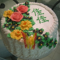 My 1St Decorated Cake - For My Sister   vanilla cake with buttercream icing. Flowers are buttercream, butterfly is wafer paper with piping gel