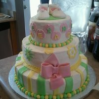 Yellow And Green my cousins baby shower cake. all white cake, bottom tier has lemon filling, middle has raspberry filling, top has strawberry filling. iced...