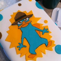 Agent P! Perry the Platypus from Phineas and Ferb. Carrot cake, cream cheese filling/frosting, cover in MMF.