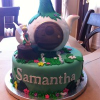 Tinkerbell House Cake Chocolate cake and vanilla buttercream. The teapot was made with rice cereal treats and chocolate