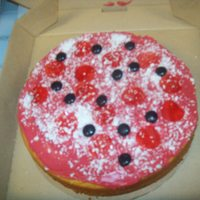 """pizza Cake"" yellow cake, fruit roll ups (pepperoni), white chocolate (grated)(parmesan cheese), icing (tinted red)"