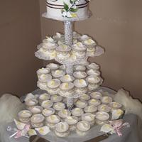 Cala Lililes Wedding cake and cupcakes for a friend, fondant, cala lilies were made from fumpaste