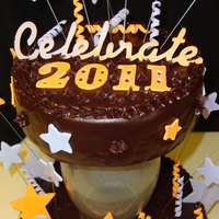 Shoot For The Stars In 2011! Happy New Year! Chocolate ganache and caramel frosting make this cake one to remember! I used my new cricut cake for the font and the stars. The gumpaste...