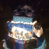 Mascarade Cake Dominican Cake..filled with pinaple and pinaple brandy syrup, it has italian meringue and decorated with fondand, black, blue, red, and...