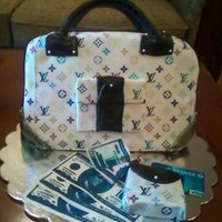 Lv Cake pineapple cake with pineapple filling covered in fondant and edible image. my first purse cake