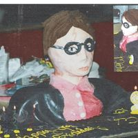Harry Potter Bust another along the lines of the spiderman cake. except that i used mmf for the covering and bc for the hair and wand( its hard to see but on...