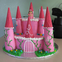 Pink Princess  Strawberry cake with strawberry glaze filling. Buttercream icing. Turrets are made of rice krispie treats covered in buttercream and...