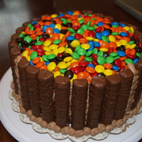 Candy Barrel This is a brownie cake with twix and mms