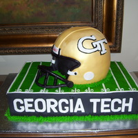 "Georgia Tech Helmet This is a groom's cake. Helmet is 3 9""rounds with the half-ball soccer pan for the top then covered in fondant. Facemask is..."