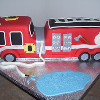 Fire Truck Yellow cake carved from a 9x13 and covered in fondant. I was sooo dreading doing this cake but it ended up not being that bad, of course I...