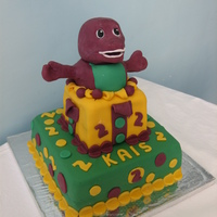 Barney barney surprise cake made with gumpaste and sugarpaste . hands were a bit tricky to do