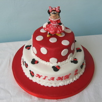 Minnie Mouse minnie figure made of modelling paste two tier choc cake with vanilla buttercream piping
