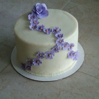 Purple Flowers I was playing around with gumpaste for the first time. Fairly happy with the results. Cake is chocolate chip with chocolate cream filling....