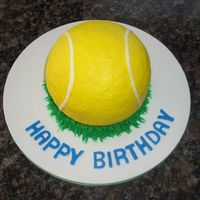 Tennis Ball Cake Tennis ball cake for my co-worker. Darn Good Chocolate Cake with chocolate filling. Buttercream icing and grass. Fondant letters.