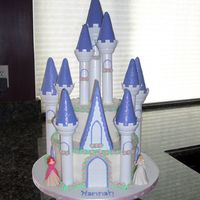 Castle Cake For Hannah's Princess Party Castle cake for my niece's Princess themed 4th bday party. The tower peaks are covered in MMF and edible sparkles. The purple accents...